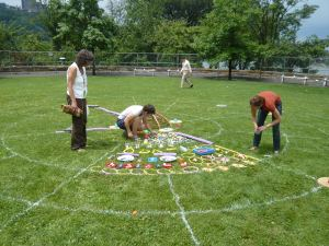 The first builders start at the center of the mandala